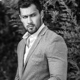 Black-white outdoor portrait of elegant handsome man in classical grey suit poses outdoor.  royalty free stock images