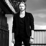 Black-white outdoor portrait of elegant long hair handsome man Stock Image