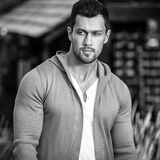 Black-white outdoor portrait of sporty handsome man in casual clothes against nature background Stock Photos