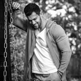 Black-white outdoor portrait of sporty handsome man in casual clothes against nature background Stock Images