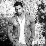Black-white outdoor portrait of sporty handsome man in casual clothes against nature background Stock Photo