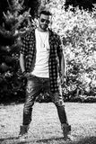 Black-white outdoor portrait of sporty stylish handsome man in casual clothes Royalty Free Stock Photography