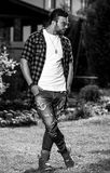 Black-white outdoor portrait of sporty stylish handsome man in casual clothes Royalty Free Stock Photos