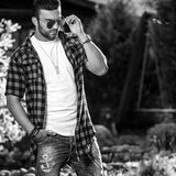 Black-white outdoor portrait of sporty stylish handsome man in casual clothes Stock Photo