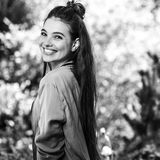 Black-white outdoors portrait of beautiful emotional positive young woman Stock Image