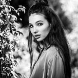 Black-white outdoors portrait of beautiful emotional positive young woman Stock Photo