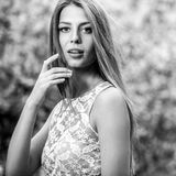 Black-white outdoors portrait of beautiful young blond woman Stock Images