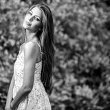 Black-white outdoors portrait of beautiful young blond woman Royalty Free Stock Photo