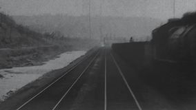 1904 - Landscape of a driving train. Black and white. A overview filmed out of a driving train in the year 1904 in the USA stock footage