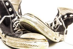 Black and white pair of Men`s or Teenager`s Grungy Dirty retro High Top tennis shoes Royalty Free Stock Image