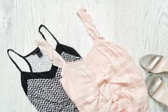 Black and white and pale pink top, silver shoes. Fashionable con. Cept Stock Images