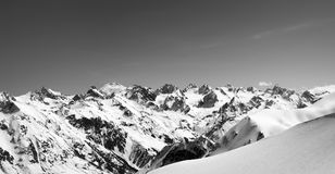 Black and white panorama of snow-capped mountains and off-piste Stock Photos