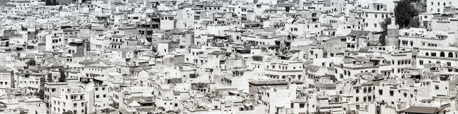 Black and white panoramic image of crowded city. Stock Photography