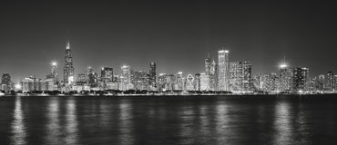 Black and white panoramic picture of Chicago city skyline at night. Black and white panoramic picture of Chicago city skyline with reflection in Lake Michigan royalty free stock image