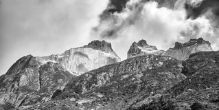 Cuernos del Paine rock formations, Chile. Black and white panoramic picture of the Cuernos del Paine rock formations in the Torres del Paine National Park royalty free stock image