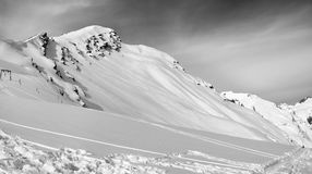 Black and white panoramic view on off-piste slope Royalty Free Stock Images