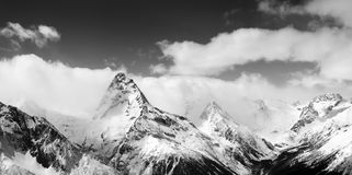 Black and white panoramic view on winter mountains in snow Royalty Free Stock Images