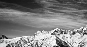 Black and white panoramic view on winter mountains at sun winter Royalty Free Stock Image