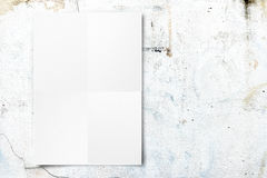 Black White paper poster hanging at concrete wall,Template mock. Up for adding your text stock photo