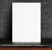 Black White paper poster lean at black brick wall and marble tab. Le,Template mock up for adding your text royalty free stock photography