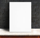 Black White paper poster lean at black brick wall and marble tab. Le,Template mock up for adding your text stock photo