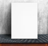 Black White paper poster lean at concrete wall and fabric table, Stock Photos