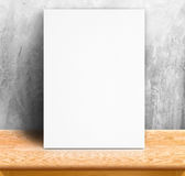 Black White paper poster lean at concrete wall and wood table,Te Stock Photography