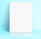 Black White paper poster lean at pastel blue color studio room,T Stock Photos