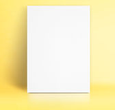Black White paper poster lean at pastel yellow studio room,Templ. Ate mock up for adding your text royalty free stock image