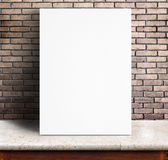 Black White paper poster lean at red brick wall and marble table. Template mock up for adding your text royalty free stock photography