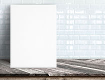 Black White paper poster lean at white ceramic tile wall and tro Stock Photography