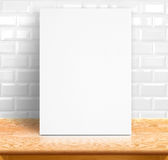 Black White paper poster lean at white ceramic tiles wall and wo. Od table,Template mock up for adding your text Royalty Free Stock Photos