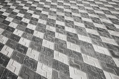 Black and white pattern of cobblestone pavement Stock Image