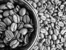Black and white pattern of coffee beans and coffee cup Stock Images