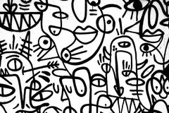 Black-and-white pattern graffiti on the wall. stock photos
