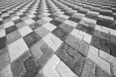 Black and white pattern of urban cobblestone pavement Stock Images