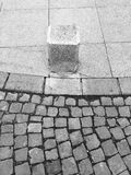 Black and white pavement close up with cement pillar Stock Image
