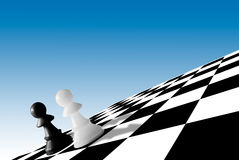 Black & white pawns on checkboard Royalty Free Stock Images