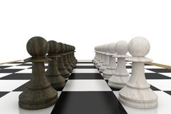 Black and white pawns facing off Royalty Free Stock Photos