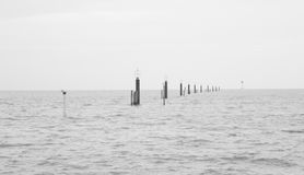 Black & white peaceful sea seascape with pillars. Before Sunset Black & white Peaceful sea seascape with pillars Royalty Free Stock Image