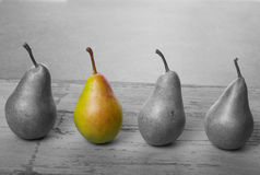 Black and white pears fruit with one piece in color Royalty Free Stock Image