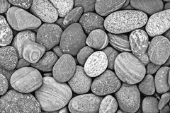 Black and white pebble stones background royalty free stock images