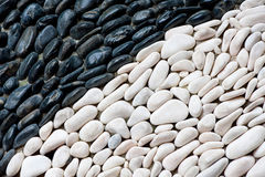Black and white pebbles Royalty Free Stock Photos