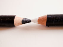 Black & White pencils. A still-life based on the concept of contrast, here represented by two pencils of opposite colours facing each other Royalty Free Stock Photo