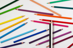 Black and white pencils top of the crayons Royalty Free Stock Images