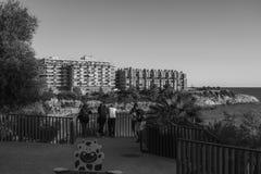 Black white with people at the coastline Costa Dorada, Salou, Spain