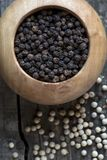 Black and white pepper royalty free stock photography
