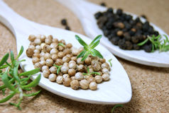 Black and white peppercorns Stock Photo