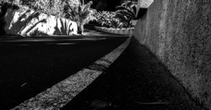Black and white perspective photo of a winding road stock images