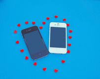 Black and white phone on blue background Royalty Free Stock Photos